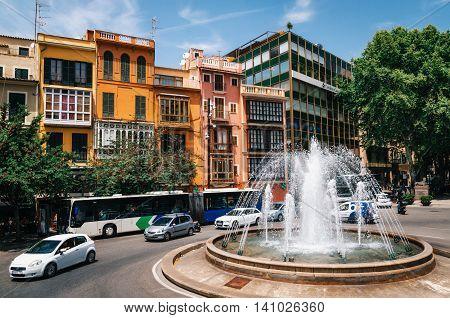 Palma de Mallorca Spain - May 27 2016: Reina Square Placa De La Reina with colourful houses and fountain