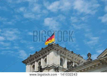 Close-up of German flag on famous Reichstag building seat of the German Parliament (Deutscher Bundestag) travel in Berlin