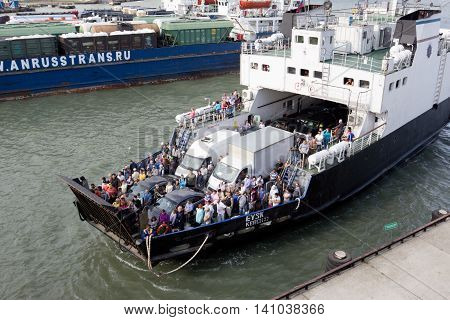 RUSSIA, PORT-KAVKAZ JUNE 12, 2014: Car ferry service between Krasnodar region and the Crimea