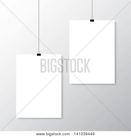 Image vector white posters hanging on binder. Grey wall with mock up empty paper blank. Layout mockup. Vertical template sheet.