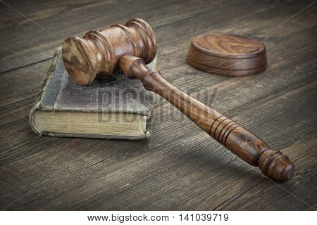 Law Book And Judges Gavel On Top On Wooden Table