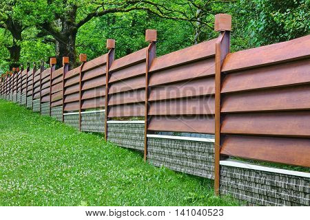 Modern Fence Made From Metal Siding Like As Natural Wood