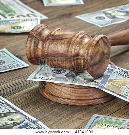 Judges Or Auctioneers Gavel And Money Stack On Wooden Background