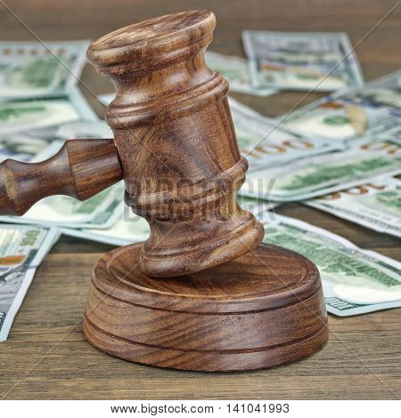 Financial Crime Or Auction Concept With Gavel And Money Background