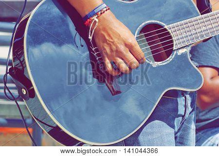 Street Musical Band Play Latin Music,  Close-up Of  Guitarist Hand
