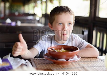 Little Child Boy Enjoying His Delicious Soup