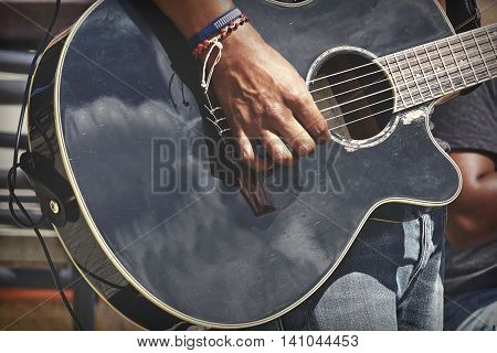Street Musical Band Play Latin Music. Close-up Of Guitarist Male Hand And Fingers Who Touches String On The Black Acoustic Guitar