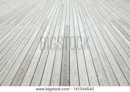 Perspective View Of Outdoor Shabby White Wood Decking Background Texture. White Wooden Plank Panel Top View. Rustic Hardwood Surface