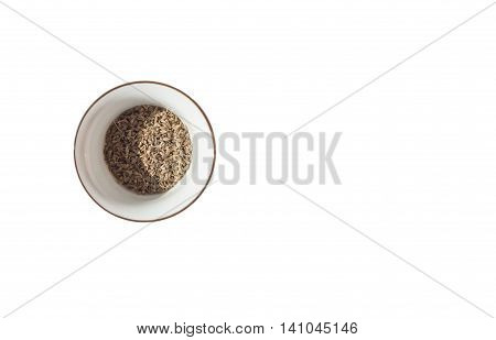 Anise, also called aniseed in the little piala on white background.