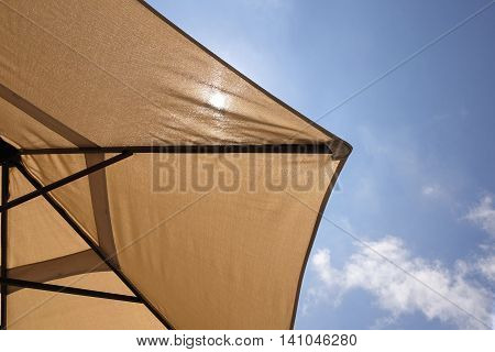 Bottom View Of Beach Umbrella Or Parasol And Sun Light Through It Blue Sky With Cirrus Clouds In The Background