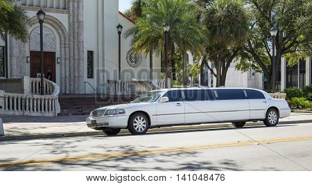 ORLANDO FLORIDA - OCTOBER 25 2014: White limousine Lincoln Town Car before Chateau Dobris