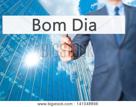 Bom Dia (in Portuguese - Good Morning) - Businessman Hand Holding Sign