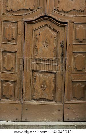 Old wooden and crooked door in Montechiaro d'Acqui Piedmonte Italy