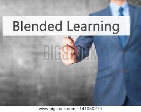 Blended Learning - Businessman Hand Holding Sign