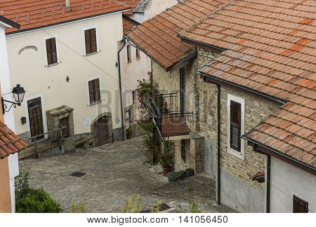 Village of Montechiaro d'Acqui in Piedmont in Italy with small center houses roofs and balconies.