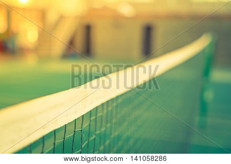 Close up of net in badminton court ( Filtered image processed vintage effect. )