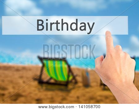 Birthday - Hand Pressing A Button On Blurred Background Concept On Visual Screen.