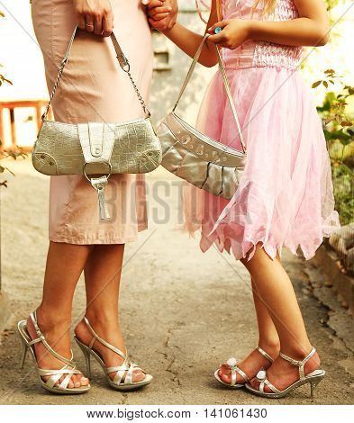 feet in sandals and bags mother with her daughter