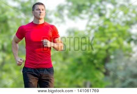 Athlete runner sprinting running to success. Fit male fitness sprinter training in sprint with determination and strength. Handsome athletic man working out outside on blue sky