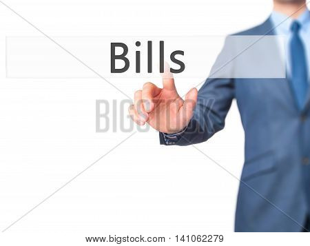 Bills - Businessman Hand Touch  Button On Virtual  Screen Interface