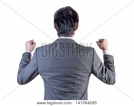 backview of businessman standing with hands up.