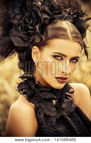 Close-up portrait of a beautiful gothic woman. Make-up, hairstyle.  Medieval history, old times. Fashion. Gothic style.