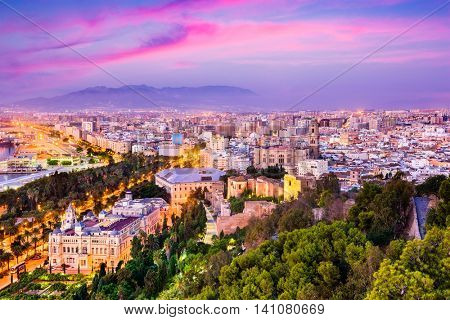 Malaga, Spain cityscape at the Cathedral, City Hall and Alcazaba citadel of Malaga.