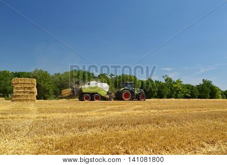 Harvester Agriculture Machine Harvesting Golden Ripe Corn Field. Tractor - Hay And Straw,  Tradition