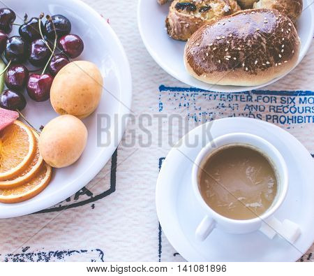 Breakfast including coffee with milk, pastries and fruits. Healthy breakfast. Good morning. Breakfast table. Morning breakfast with kruassan. Top view.