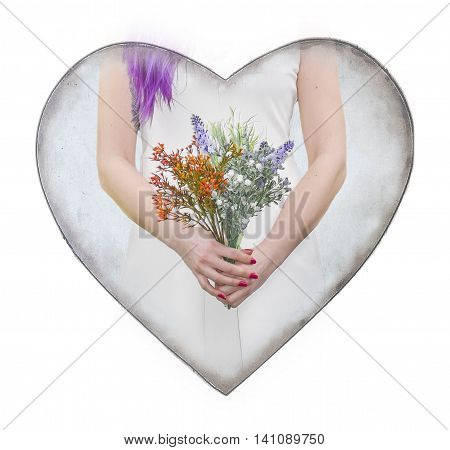 Isolated on white love motif ornament created from heart shape graphic and woman hands holding flowers