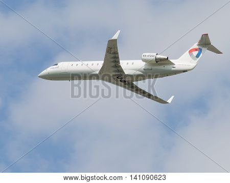 Moscow region - 31 July 2016: passenger plane Bombardier CRJ-200LR Severstal Airlines flies to Domodedovo airport July 31 2016 Moscow Region Russia