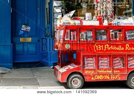 London UK - July 13 2016 - Red double decker model filled with English souvenirs on Portobello Road in Notting Hill