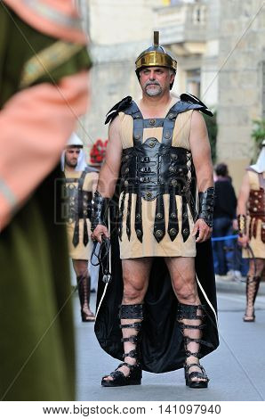 MOSTA, MALTA - APR 22 : Roman centurion during the Good Friday procession in the village of Mosta in Malta April 22, 2011
