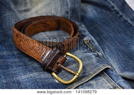 leather belt close-up put on Blue jeans