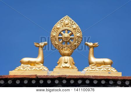 Buddhist symbol on the roof of Jharkot village gompa round Annapurna circuit trekking trail Nepal