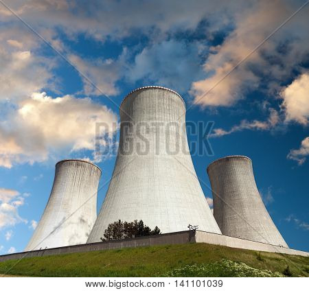 Evening colored sunset view of cooling tower - Nuclear power plant Dukovany - Czech Republic