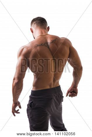 Handsome shirtless muscular man, standing, isolated on white background in studio shot
