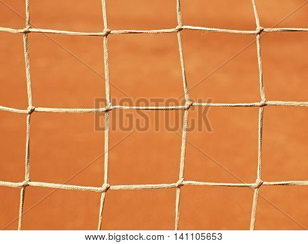 Old Net With The Ground And White Line Tennis Court. Dry Red Clay. Light Red Crushed Bricks Surface