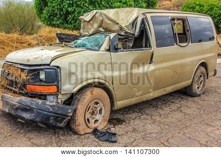 Nopolo, Baja, Baja California Sur, Mexico - August 25, 2013: Destroyed cars and covered with mud during the tropical storm named Juliette