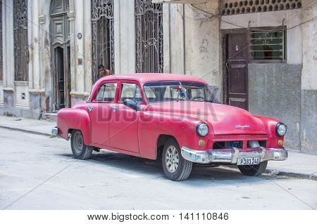 HAVANA CUBA - JULY 18 : Old classic American car on one of Havana's streets on July 18 2016. There is nearly 60000 vintage American cars in Cuba