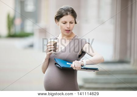 Stressed Pregnant Woman Looking At Watch