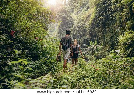 Young Couple Walking Through Woods