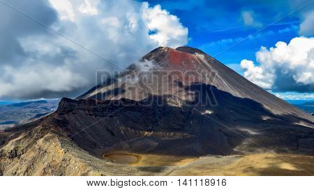 Big volcano, mountain and crater with clouds and shadow