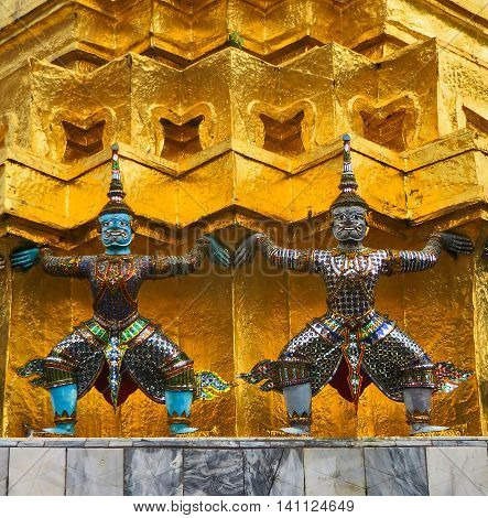 Temple guards figures in elaborate gold and jewels