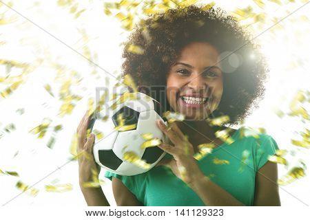 Latina young woman on green celebrating