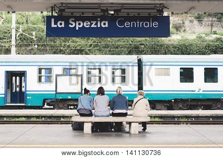La Spezia Italy - Apr 8 2016: Unidentified four European female travelers young and senior wait for train at La Spezia Central public train station visiting Cinque Terre Italy