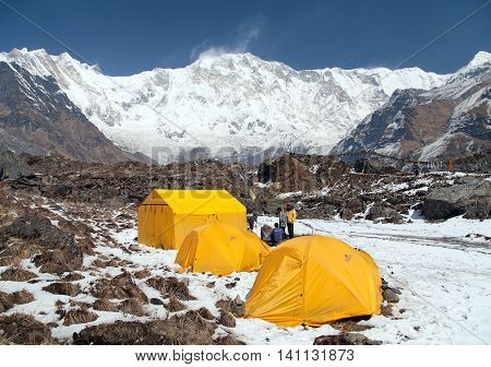 ANNAPURNA BASE CAMP NEPAL12th APRIL 2016 - View of Mount Annapurna with tents and people from base camp Nepal