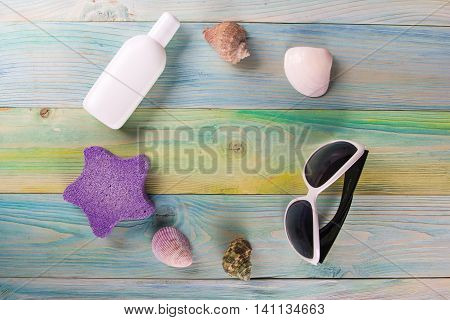 Summer sea vacation background. Notebook blank page with Travel items on blue green wooden table. Sea shells, pebbles, top view mockup