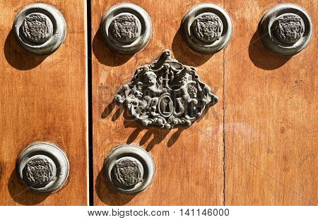 Closeup at the wonderful cast iron locker of the main door of the Archbishop Palace in Seville Spain