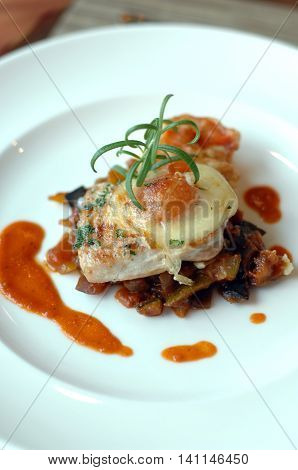 Vegetable lasagne on plain white plate and smear